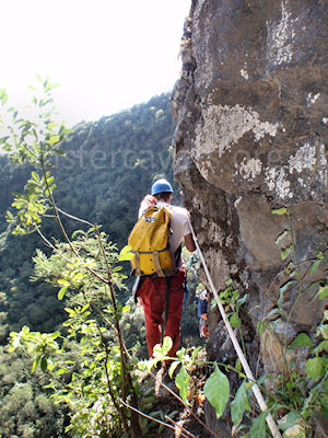 A canyoneer on the exposed traverse from the Grotte de la Grande Ravine, Ile de la Reunion, September 2009